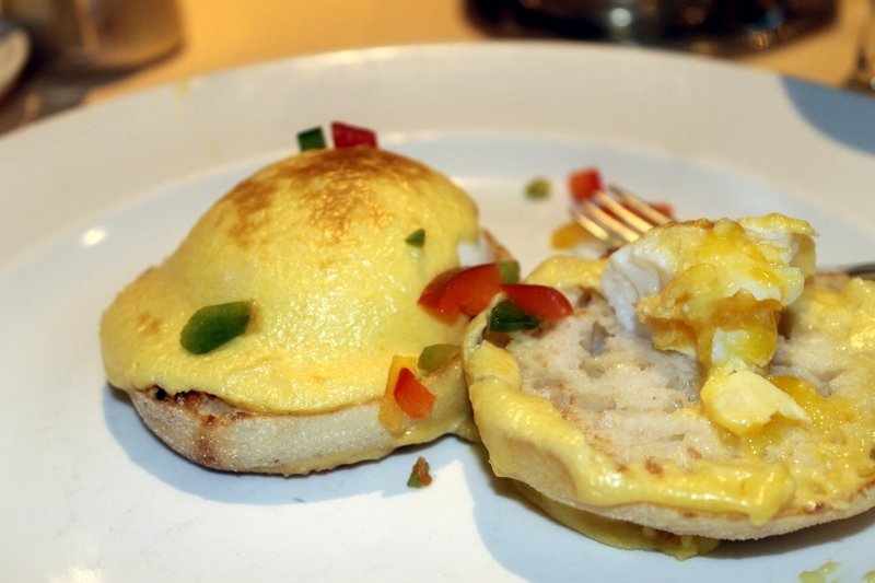two poaced eggs on an English muffin (Eggs Benedict) without the ham/Canadian bacon - I ate one egg before I took the photo