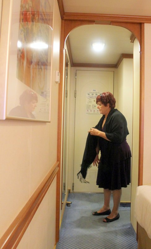 Polly getting ready for formal night - full length mirror beside the door