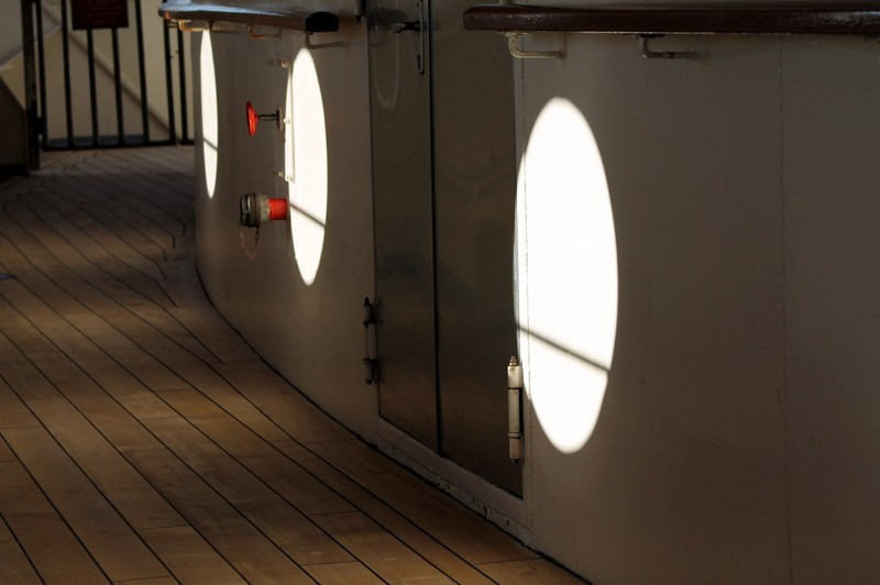 sunlight through the bow portholes