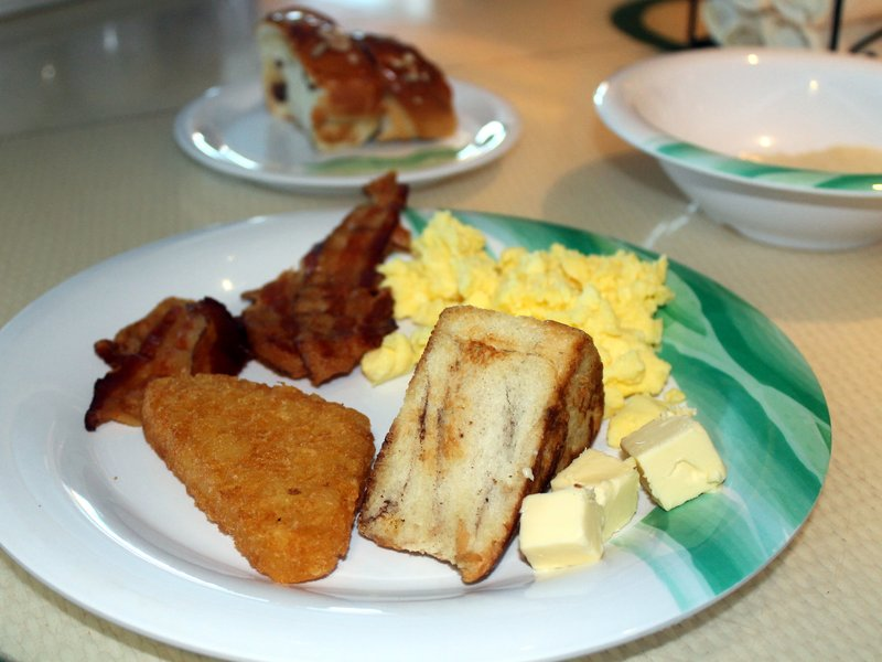 Breakfast - Lido -  grits, eggs, bacon and raisin bread.