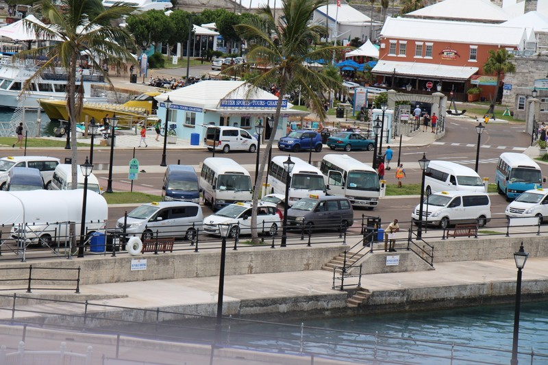 Taxis and buses waiting for passengers