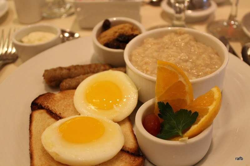 Poached eggs, oatmeal with raisins & brown sugar and pork sausage