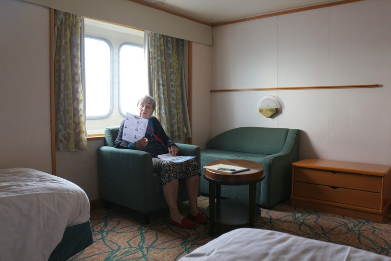 Barbara reading the cruise guide