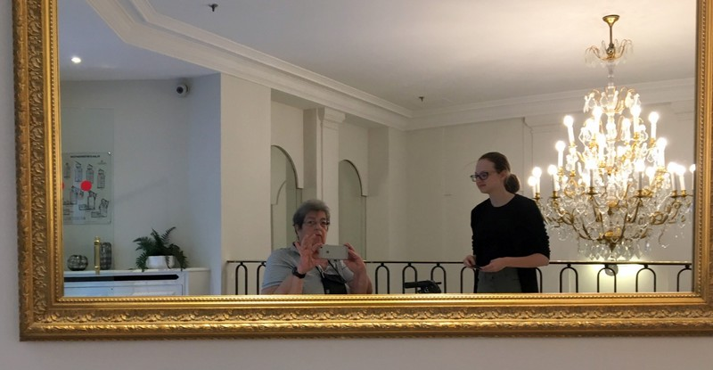 A and me in the mirror going to the room