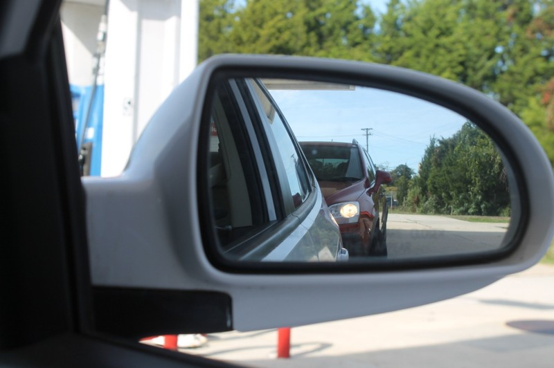 Side mirror at toll booth