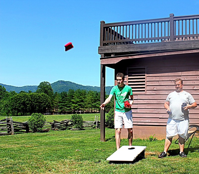 Texas grandson and Son playing cornhole