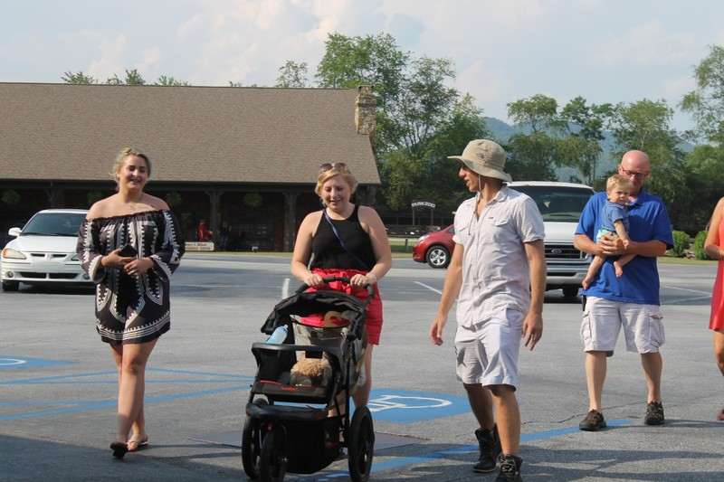 Grandson's fiance pushing the stroller, her brother and her father with our great grandson