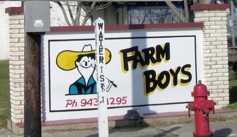 Farm Boys sign behind Water Street sign
