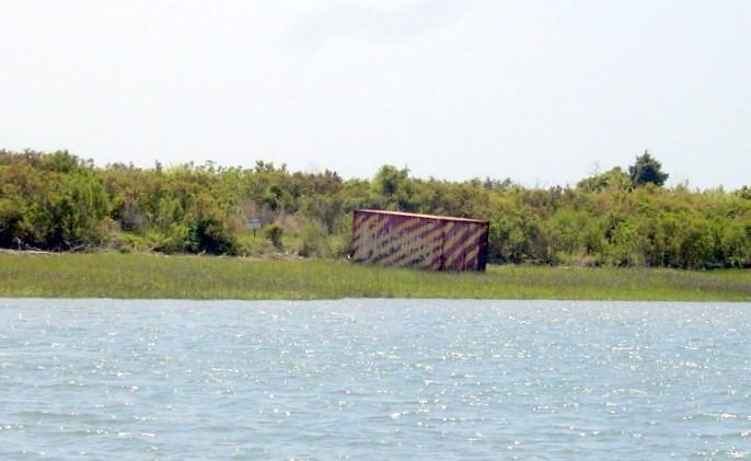 Large metal box on shore - marine base