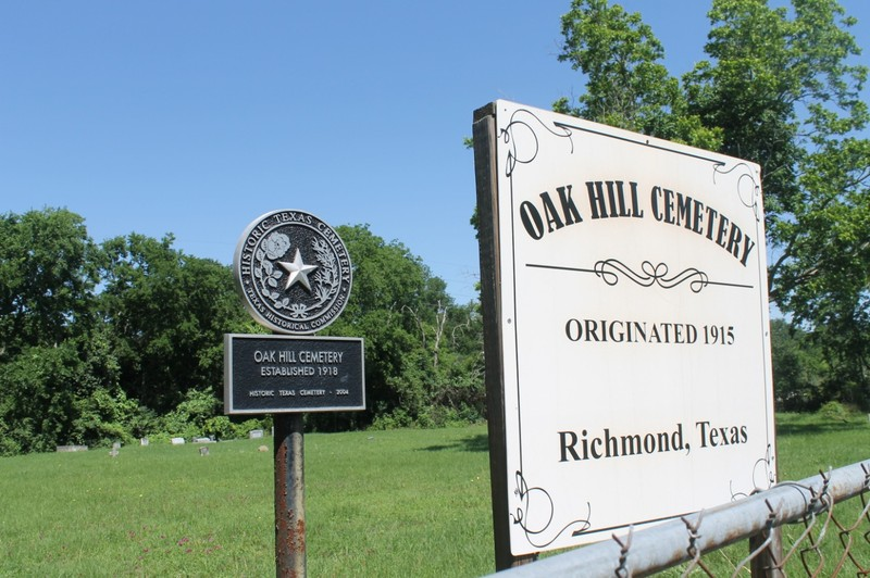 Oak Hill Cemetery Historic sign - graves behind it.