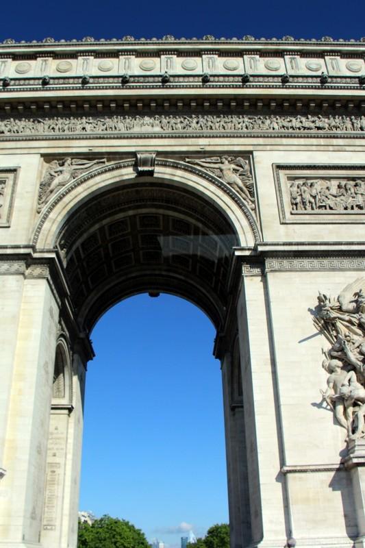 Arc de Triomphe from a car in the Place de l'Étoile