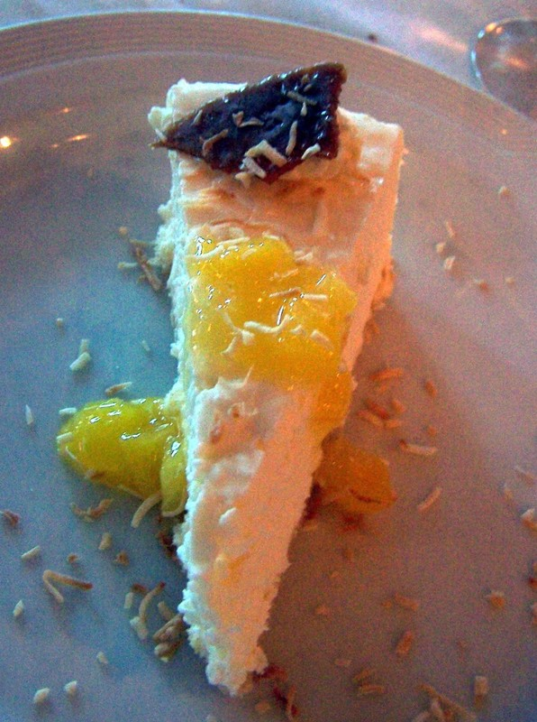 A small sliver of coconut cheesecake.