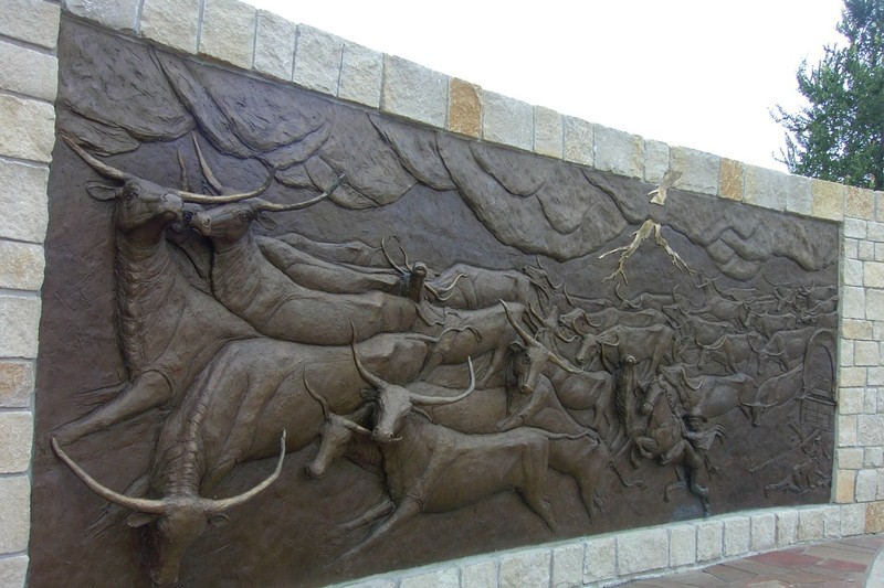 Bas relief showing the lightening stampeding the steers