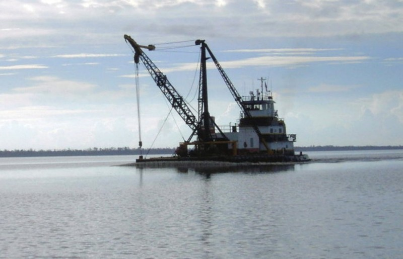 Tug with crane in the Alligator River
