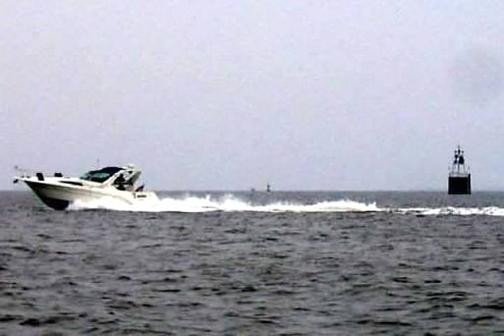 Speed boat by Tangier Light