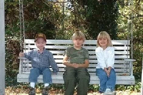 Three grandchildren in our yard
