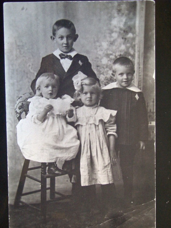 Photo taken about 1911 - In the back my dad's older brother Ernest. The baby on the stool is Harry.  In the middle his older sister Margaret and on the right my Dad.  His younger sister Mary hadn't been born yet.