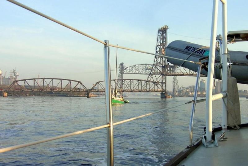 Green sailboat MARGIRETA and Jordan Bridge