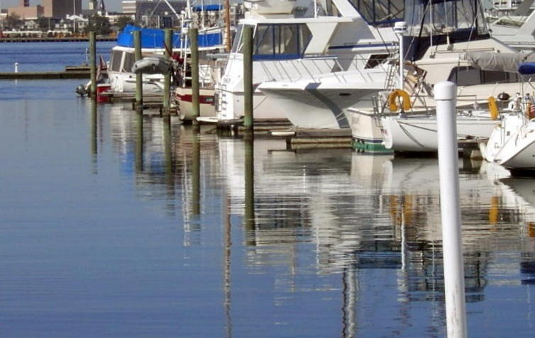 Looking down the sterns of the boats in the marina