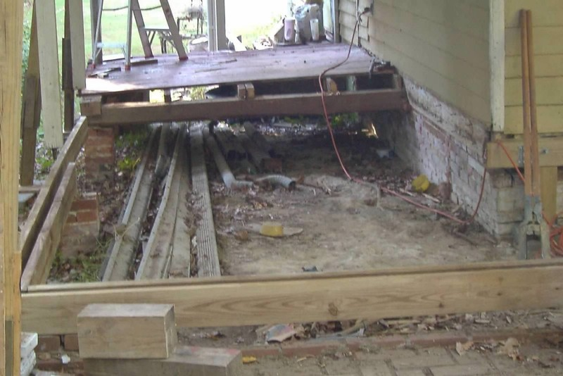 taking out the old rotten wood