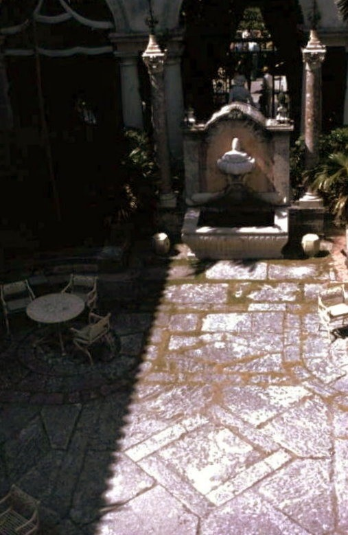 Looking down at a fountain in the courtyard