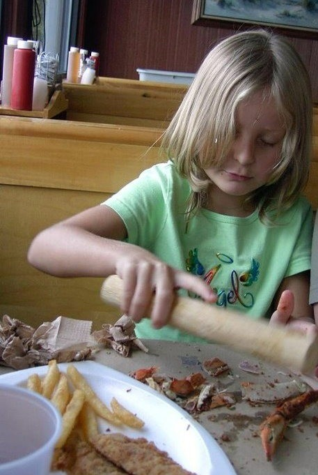 Granddaughter eating crabs