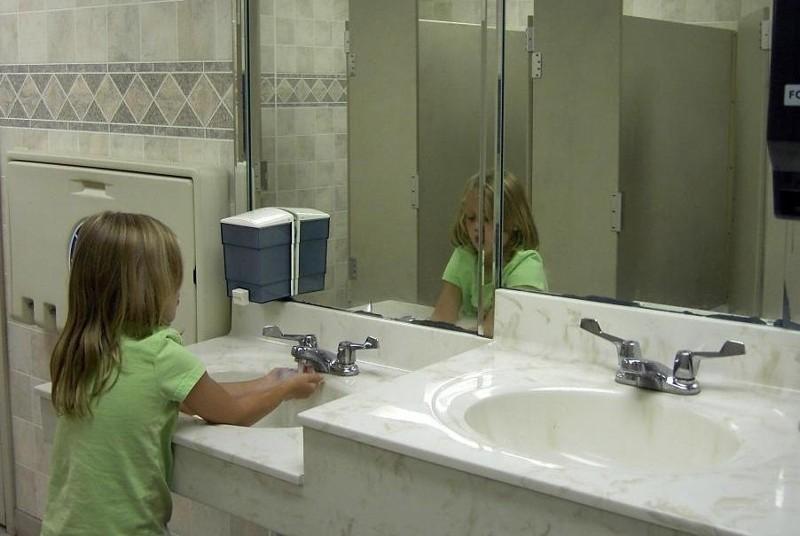 Granddaughter washing her hands