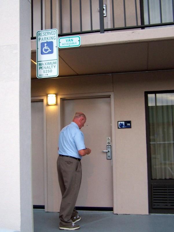 Bob unlocking the motel room door