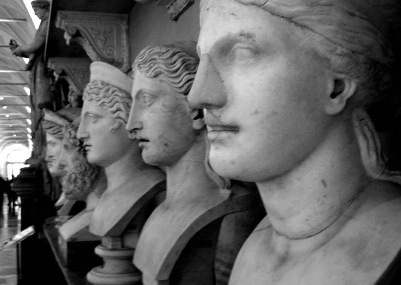 line of marble heads