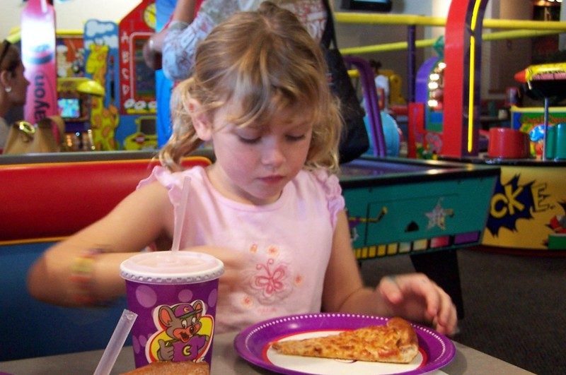 granddaughter with Chuckie Cheese pizza