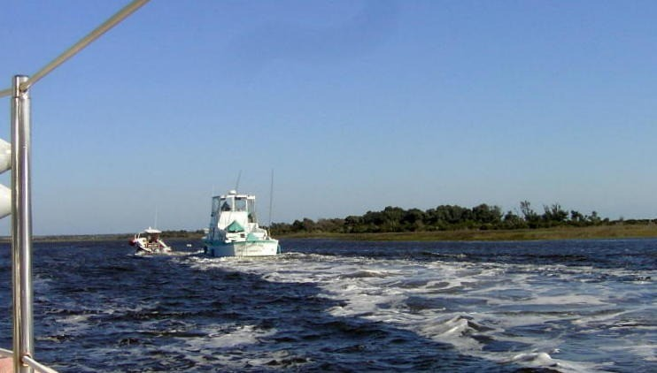 Tow Boat towing a boat