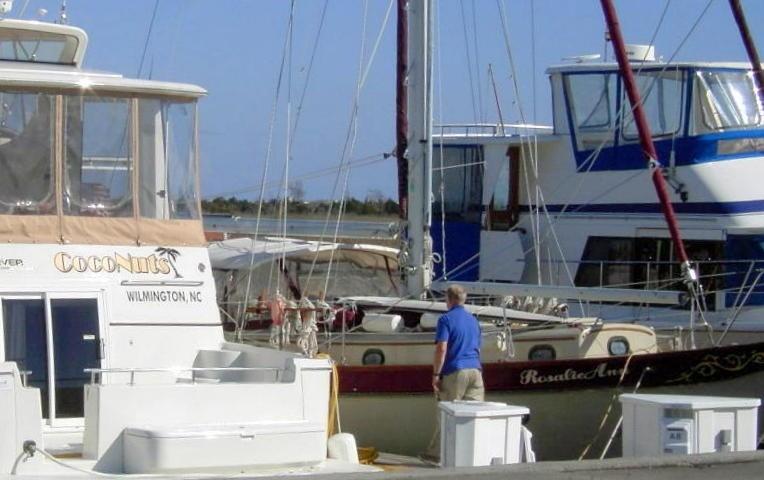 RosalieAnn and Bob between two big power boats