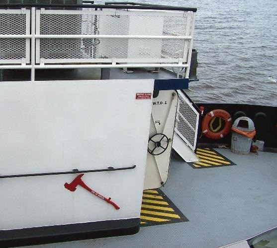 Ferry deck with black and yellow stripes where doors open