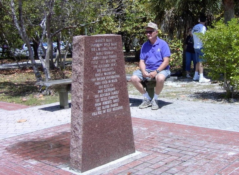 Bob sitting by the monument to the lighthouse restoration