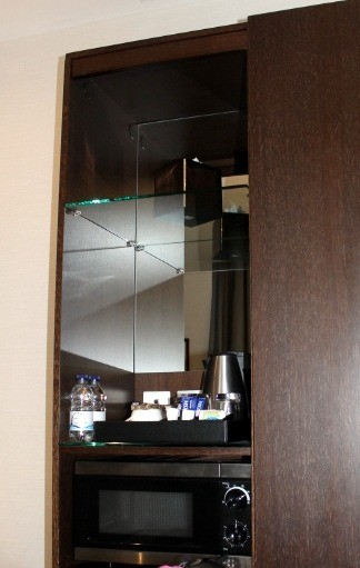 Mirror and mini bar over microwave and fridge
