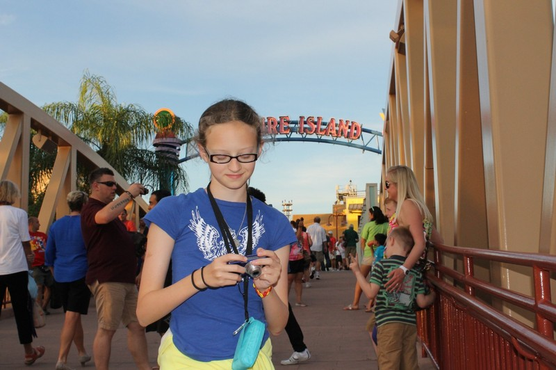Granddaughter with camera in Downtown Disney