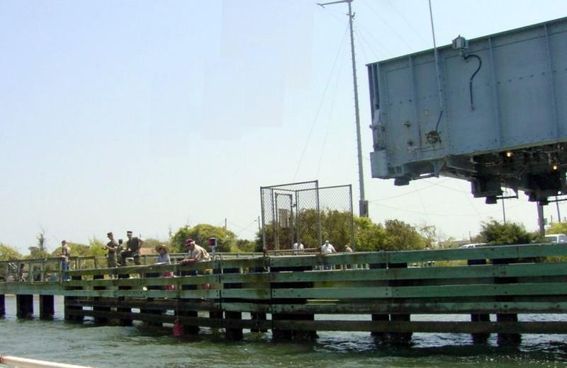 Fishermen on the bridge fenders