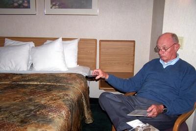 Bob at the Sleep Inn with the TV controller