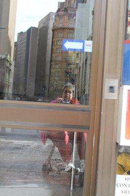 me reflected in the phone store door