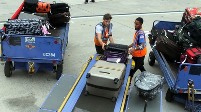 Loading the Luggie bag into the plane