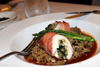 Stuffed chicken with rice and asparagus which she cut up herself