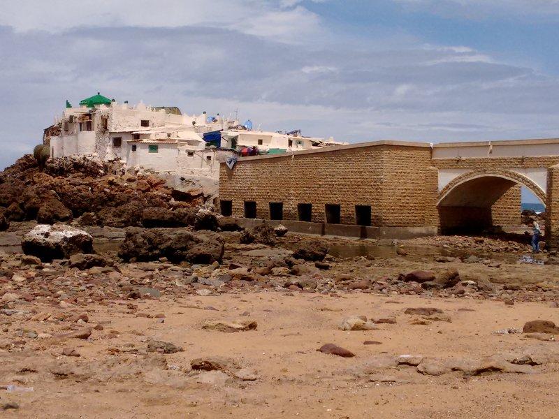 Casablanca Ain Diab beach, Morocco, the  Mausoleum of Sidi Abderrahman viewed  from the rocky beach.