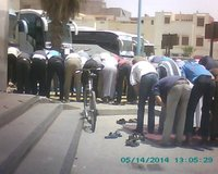 Essaouira Gare Routiere workers stop for prayers.