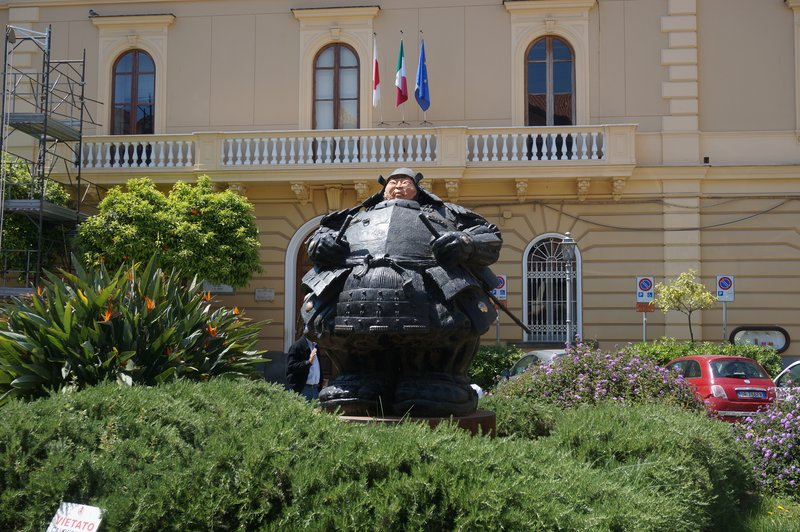 Statue of rotund man in Sorrento piazza