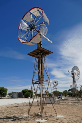 Two views of the windmill from Anna Creek Station