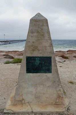 The cairn with plaque explaining how the town got its name