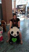 Girl riding a panda bear