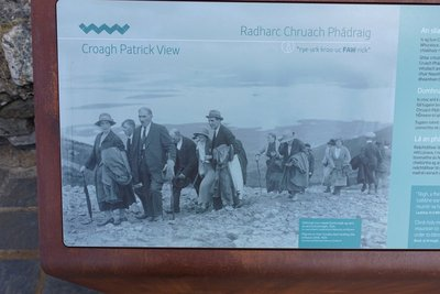 photo of pilgrims back in the day all dressed in their good gear climbing the mountain