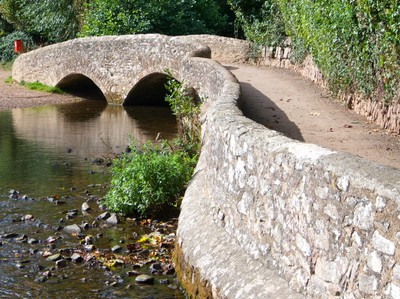 Gallox Bridge, a medieval packhorse bridge across the River Avill (circa 15th Century). Gallox refers to the execution gallows on Gallox Hill.