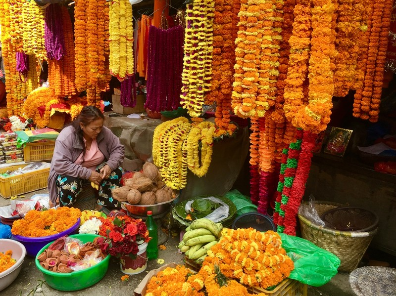Marigold garland on sale for the offering to the Sleeping Lord Vishnu at Budhanilkantha